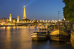 Barges along River Seine with Eiffel Tower beyond, Paris, France