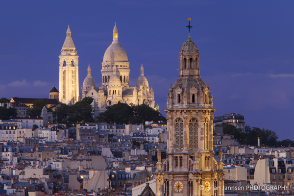 Tower of Trinite d' Estienne d' Orves Church with Sacre Coeur at twilight, Paris France