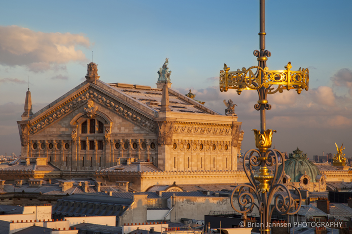 Sunset over Palais Garnier - the Opera House - viewed from top of Printemps, Paris France