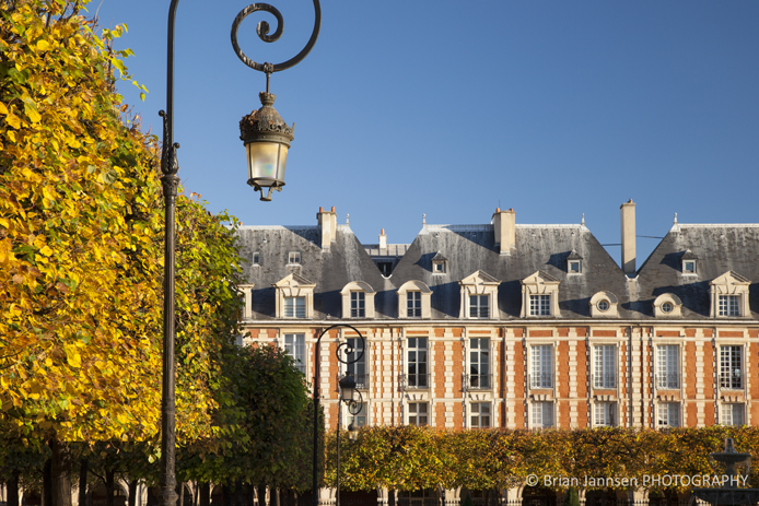 Lamps and achitecture in Place des Vosge - the oldest public square in Paris, Ile-de-France, France